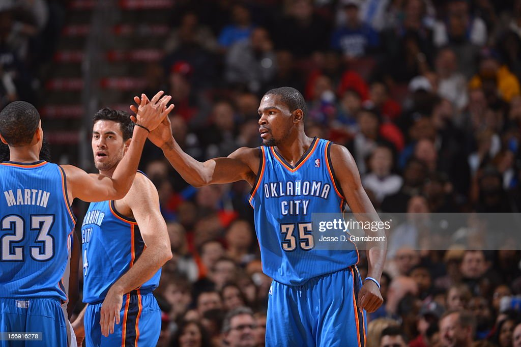 Kevin Durant #35 and Kevin Martin #23 of the Oklahoma City Thunder Slap hands against the Philadelphia 76ers during the game at the Wells Fargo Center on November 24, 2012 in Philadelphia, Pennsylvania.