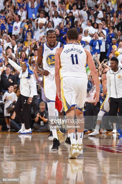 Kevin Durant and Klay Thompson of the Golden State Warriors celebrate during the game against the Houston Rockets on October 17 2017 at ORACLE Arena...