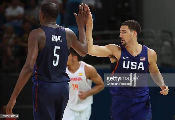 Kevin Durant and Klay Thompson of United States celebrate a play against Spain during the Men's Semifinal match on Day 14 of the Rio 2016 Olympic...