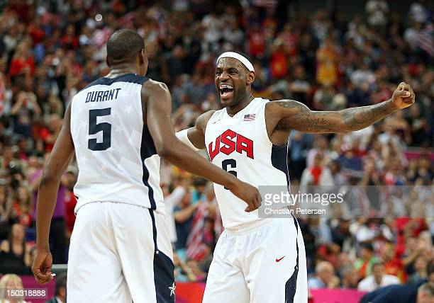 Kevin Durant and LeBron James of the United States celebrate in the Men's Basketball gold medal game between the United States and Spain on Day 16 of...