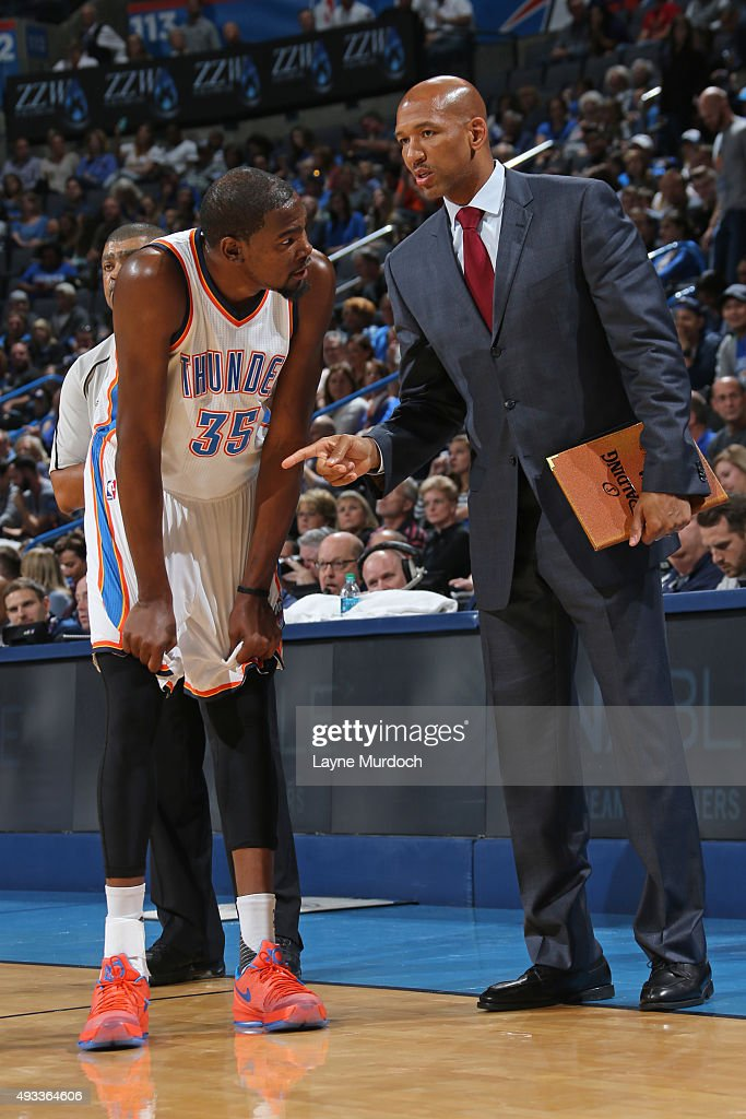 Kevin Durant and Monty Williams of the Oklahoma City Thunder talk against the Denver Nuggets during a preseason game on October 18 2015 at the...