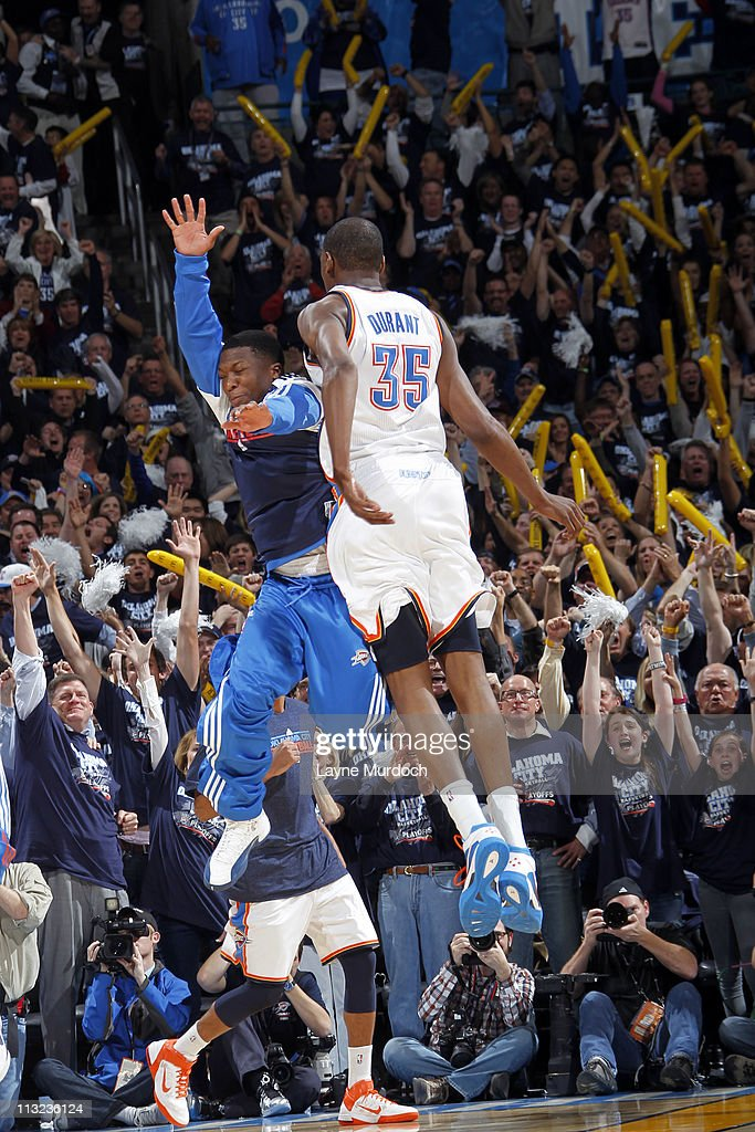 Kevin Durant #35 and Nate Robinson #3 of the Oklahoma City Thunder celebrate defeating the Denver Nuggets in Game Five of the Western Conference Quarterfinals on April 27, 2011 at the Oklahoma City Arena in Oklahoma City, Oklahoma.