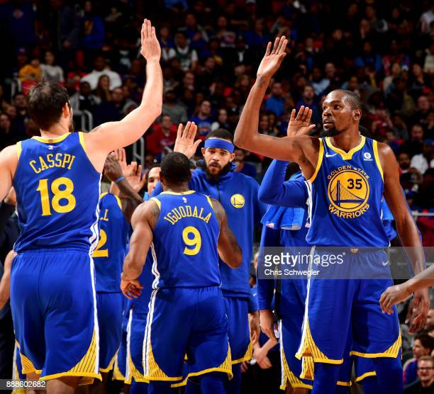 Kevin Durant and Omri Casspi of the Golden State Warriors high five during the game against the Detroit Pistons on December 8 2017 at Little Caesars...