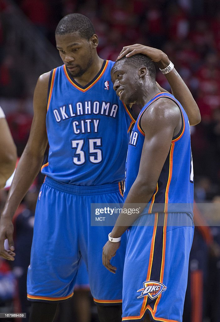 Kevin Durant (35) and Reggie Jackson (15) of the Oklahoma City Thunder congratulate each other in the closing seconds against the Houston Rockets in the second half of their Western Conference playoff game game on Friday, May 3, 2013, in Houston, Texas.