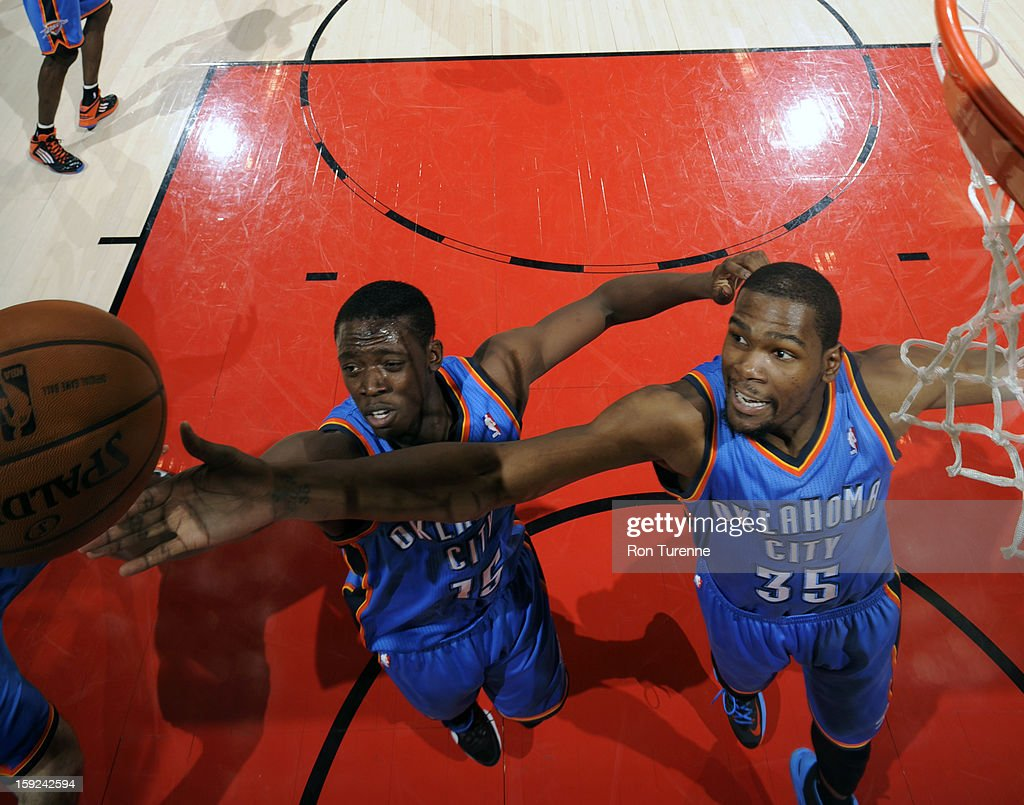 <a gi-track='captionPersonalityLinkClicked' href=/galleries/search?phrase=Kevin+Durant&family=editorial&specificpeople=3847329 ng-click='$event.stopPropagation()'>Kevin Durant</a> #35 and Reggie Jackson #15 of the Oklahoma City Thunder go up for a rebound against the Toronto Raptors on January 6, 2013 at the Air Canada Centre in Toronto, Ontario, Canada.