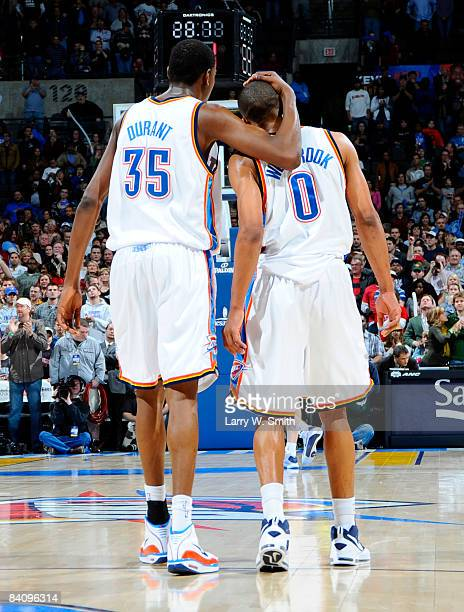 Kevin Durant and Russell Westbrook give each other pats on the back seconds before a win against the Toronto Raptors at the Ford Center on December...