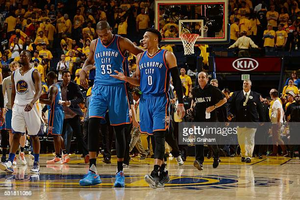 Kevin Durant and Russell Westbrook of the Oklahoma City Thunder after the win against the Golden State Warriors during Game One of the Western...