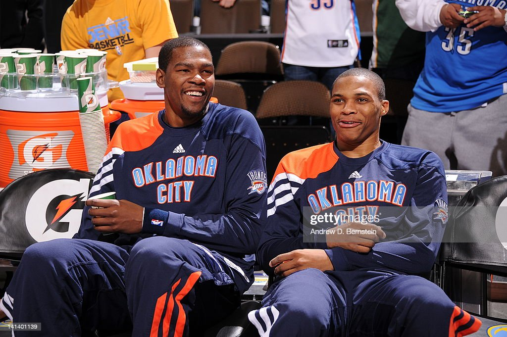 Kevin Durant #35 and Russell Westbrook #0 of the Oklahoma City Thunder enjoy a laugh on the bench before the start against the Denver Nuggets on March 15, 2012 at the Pepsi Center in Denver, Colorado.