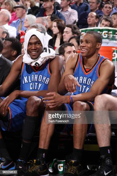 Kevin Durant and Russell Westbrook of the Oklahoma City Thunder laugh on the bench during a game against the Portland Trail Blazers on February 9...