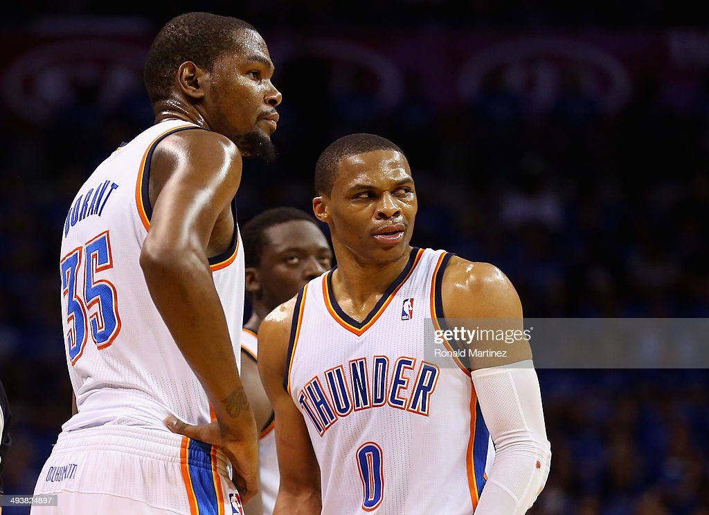 Kevin Durant #35 and Russell Westbrook #0 of the Oklahoma City Thunder look on after a call in the second quarter against the San Antonio Spurs during Game Three of the Western Conference Finals of the 2014 NBA Playoffs at Chesapeake Energy Arena on May 25, 2014 in Oklahoma City, Oklahoma.