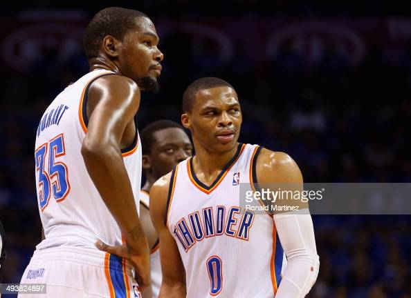 Kevin Durant and Russell Westbrook of the Oklahoma City Thunder look on after a call in the second quarter against the San Antonio Spurs during Game...