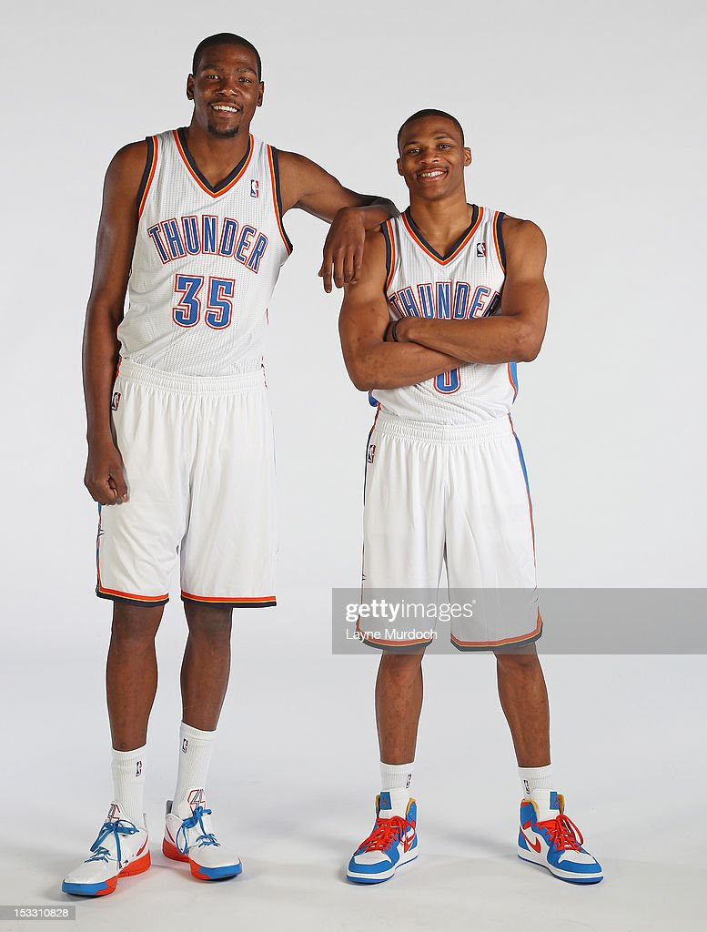Kevin Durant #35 and Russell Westbrook #0 of the Oklahoma City Thunder pose for a portrait during 2012 NBA Media Day on October 1, 2012 at the Thunder Events Center in Edmond, Oklahoma.