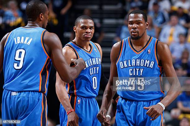 Kevin Durant and Russell Westbrook of the Oklahoma City Thunder react against the Memphis Grizzlies during Game Six of the Western Conference...