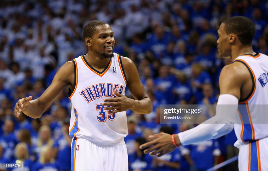 Kevin Durant #35 and Russell Westbrook #0 of the Oklahoma City Thunder react after a play in the third quarter against the San Antonio Spurs during Game Four of the Western Conference Finals of the 2014 NBA Playoffs at Chesapeake Energy Arena on May 27, 2014 in Oklahoma City, Oklahoma.
