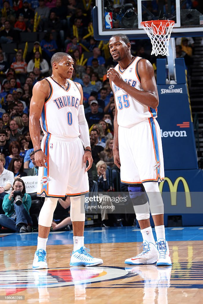 Kevin Durant #35 and Russell Westbrook #0 of the Oklahoma City Thunder talk it over vs the Cleveland Cavaliers during an NBA game on November 11, 2012 at the Chesapeake Energy Arena in Oklahoma City, Oklahoma.