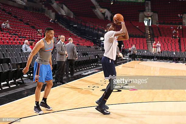 Kevin Durant and Russell Westbrook of the Oklahoma City Thunder warm up before the game against the Portland Trail Blazers on April 6 2016 at Moda...