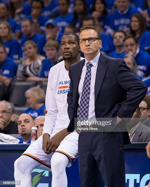 Kevin Durant and Scott Brook head coach of the Oklahoma City Thunder during the game against the San Antonio Spurs in Game 3 of the Western...