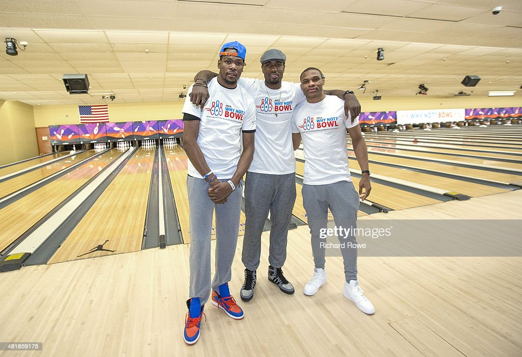 Kevin Durant #35 and Serge Ibaka #9 join Russell Westbrook #0 of the Oklahoma City Thunder at his annual Why Not Foundation fundraiser to benefit the Boys and Girls Club at AMC Boulevard Bowl in Edmond, Oklahoma.