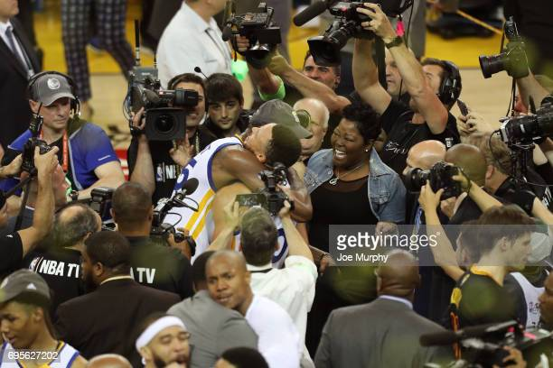 Kevin Durant and Stephen Curry of the Golden State Warriors celebrate with Wanda Durant after winning Game Five of the 2017 NBA Finals against the...