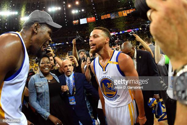 Kevin Durant and Stephen Curry of the Golden State Warriors celebrate after winning Game Five of the 2017 NBA Finals against the Cleveland Cavaliers...