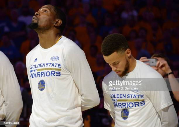 Kevin Durant and Stephen Curry of the Golden State Warriors during the national anthem before the game against the Cleveland Cavaliers in Game Five...