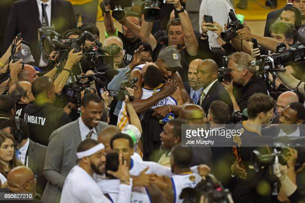 Kevin Durant and Stephen Curry of the Golden State Warriors hug and celebrate after winning Game Five of the 2017 NBA Finals against the Cleveland...