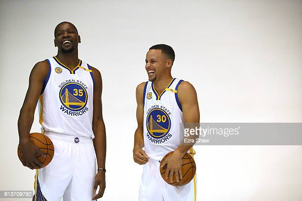 Kevin Durant and Stephen Curry of the Golden State Warriors pose for photographers during the Golden State Warriors Media Day at the Warriors...