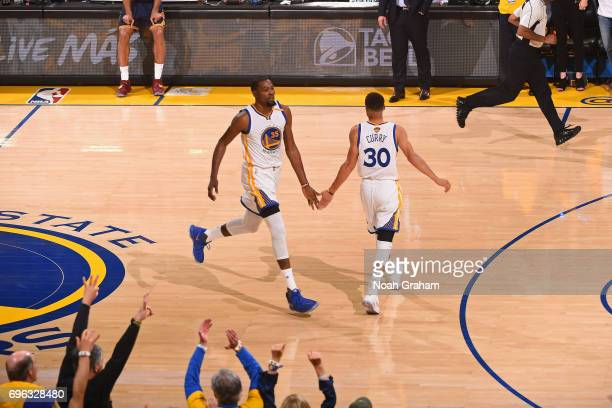 Kevin Durant and Stephen Curry of the Golden State Warriors shake hands in Game One of the 2017 NBA Finals against the Cleveland Cavaliers on June 1...