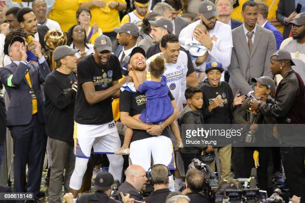 Kevin Durant and Stephen Curry of the Golden State Warriors smile and celebrate on stage after winning Game Five of the 2017 NBA Finals against the...