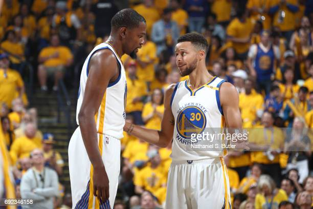 Kevin Durant and Stephen Curry of the Golden State Warriors talk during the game against the Cleveland Cavaliers in Game Two of the 2017 NBA Finals...