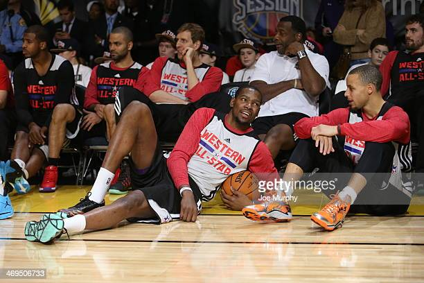 Kevin Durant and Stephen Curry of the Western Conference AllStars talk during the NBA AllStar Practices at Sprint Arena as part of 2014 NBA AllStar...