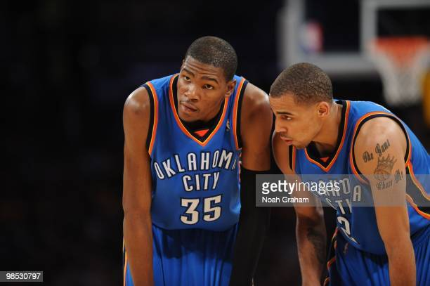 Kevin Durant and Thabo Sefolosha of the Oklahoma City Thunder look on against the Los Angeles Lakers in Game One of the Western Conference...