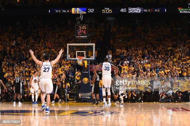 Kevin Durant and Zaza Pachulia of the Golden State Warriors react during the game against the San Antonio Spurs during Game One of the Western...