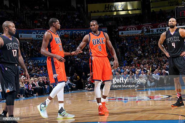 Kevin Durant celebrates a play with teammate Serge Ibaka of the Oklahoma City Thunder against the Phoenix Suns on November 8 2015 at Chesapeake...