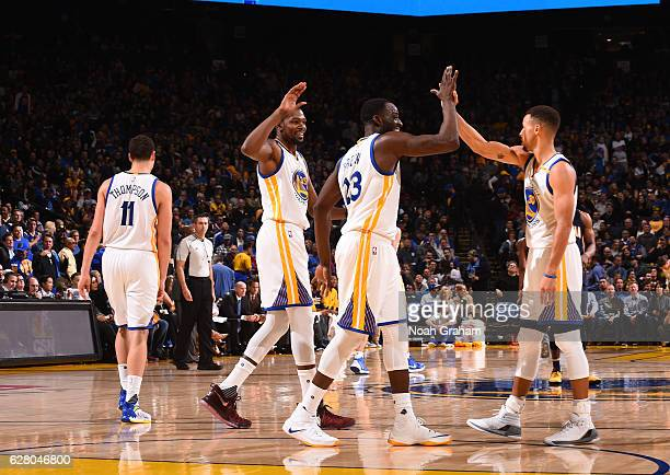 Kevin Durant Draymond Green and Stephen Curry of the Golden State Warriors celebrates during the game against the Indiana Pacers on December 5 2016...
