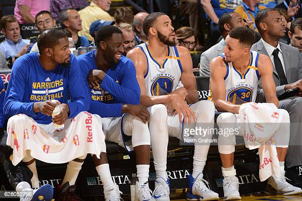 Kevin Durant Draymond Green JaVale McGee and Stephen Curry of the Golden State Warriors sit on the bench during the game against the Indiana Pacers...