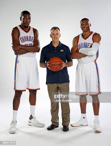 Kevin Durant head coach Billy Donovan and Russell Westbrook of the Oklahoma City Thunder pose for a portrait during 2015 NBA Media Day on September...
