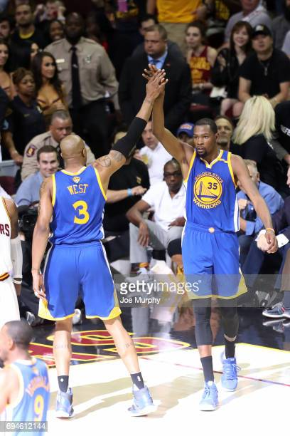 Kevin Durant high fives David West of the Golden State Warriors during the game against the Cleveland Cavaliers in Game Four of the 2017 NBA Finals...