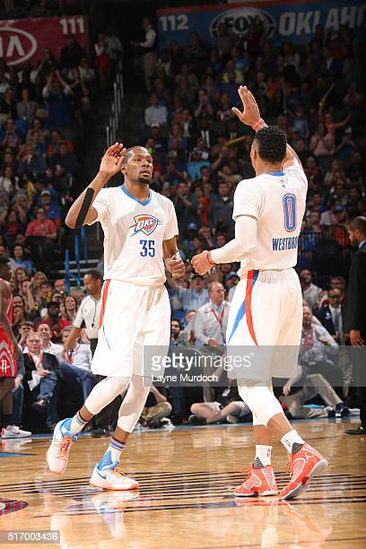 Kevin Durant high fives Russell Westbrook of the Oklahoma City Thunder during the game against the Houston Rockets on March 22 2016 at Chesapeake...