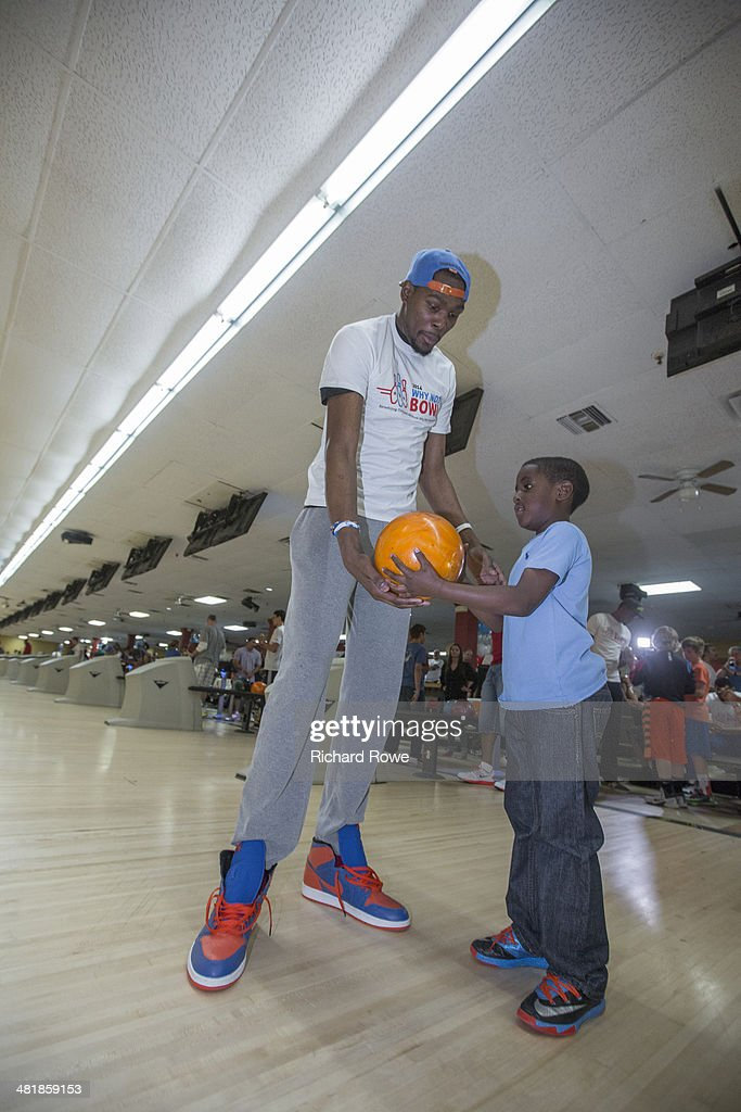 Kevin Durant #35 joins Russell Westbrook #0 of the Oklahoma City Thunder at his annual Why Not Foundation fundraiser to benefit the Boys and Girls Club at AMC Boulevard Bowl in Edmond, Oklahoma.