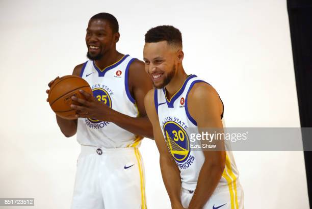Kevin Durant jokes with Stephen Curry of the Golden State Warriors during the Golden States Warriors media day at Rakuten Performance Center on...