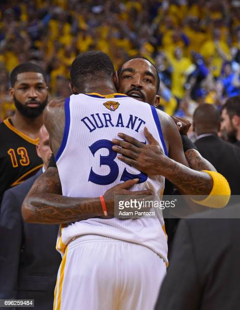 Kevin Durant of the Golden State Warriors and JR Smith of the Cleveland Cavaliers hug after Game Five of the 2017 NBA Finals on June 12 2017 at...