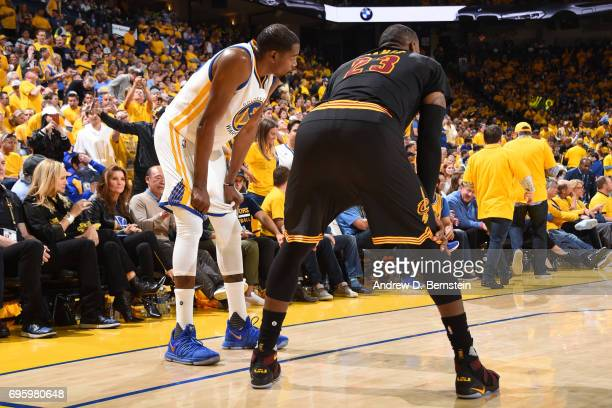 Kevin Durant of the Golden State Warriors and LeBron James of the Cleveland Cavaliers in Game Five of the 2017 NBA Finals on June 12 2017 at ORACLE...