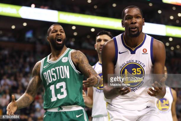 Kevin Durant of the Golden State Warriors and Marcus Morris of the Boston Celtics dispute a call during the third quarter at TD Garden on November 16...