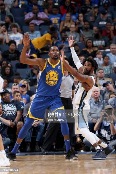Kevin Durant of the Golden State Warriors and Mike Conley of the Memphis Grizzlies play against one another on October 21 2017 at FedExForum in...