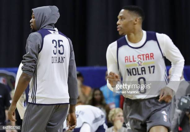 Kevin Durant of the Golden State Warriors and Russell Westbrook of the Oklahoma City Thunder attend practice for the 2017 NBA AllStar Game at the...