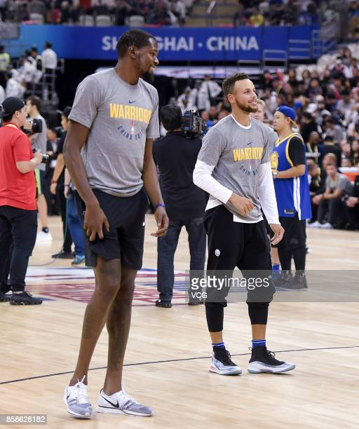 Kevin Durant of the Golden State Warriors and Stephen Curry of the Golden State Warriors react during fan day as part of 2017 NBA Global Games China...