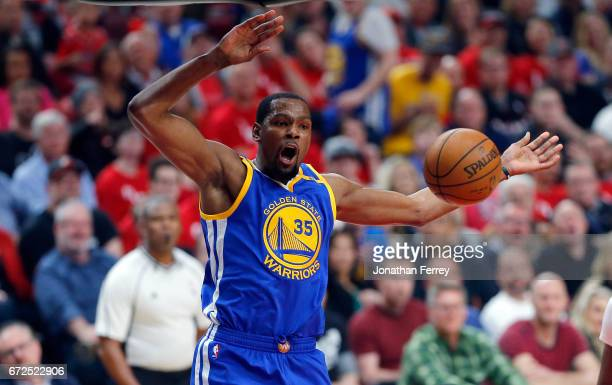 Kevin Durant of the Golden State Warriors blocks celebrates a dunk against the Portland Trail Blazers during Game Four of the Western Conference...