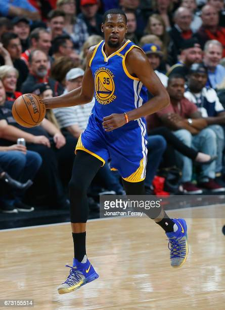 Kevin Durant of the Golden State Warriors bribbles the ball against the Portland Trail Blazers during Game Four of the Western Conference...