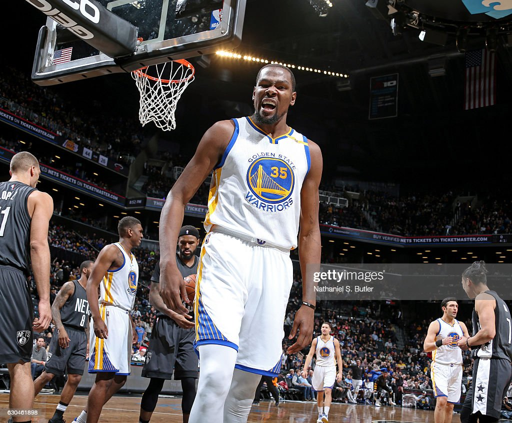 Kevin Durant #35 of the Golden State Warriors celebrates a dunk during the game against the Brooklyn Nets on December 22, 2016 at Barclays Center in Brooklyn, NY.